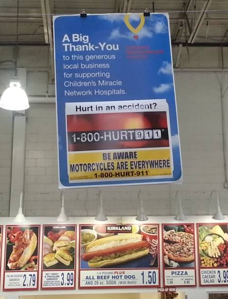 motorcycle awareness billboards at COSTCO stores